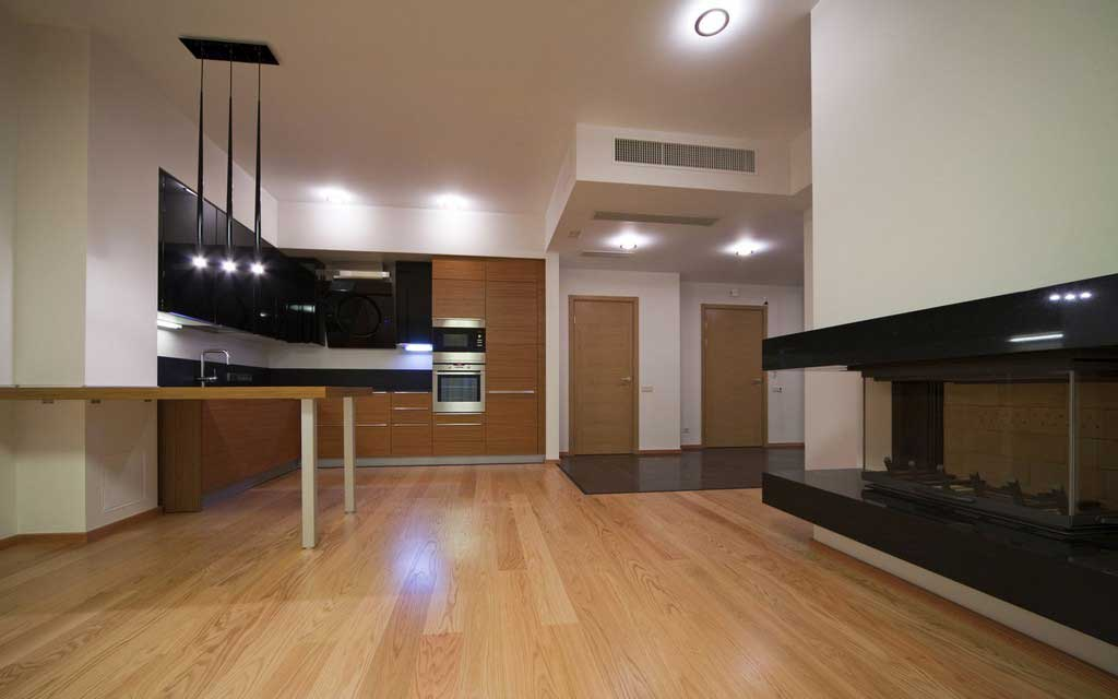 A customized basement with a kitchen and fireplace