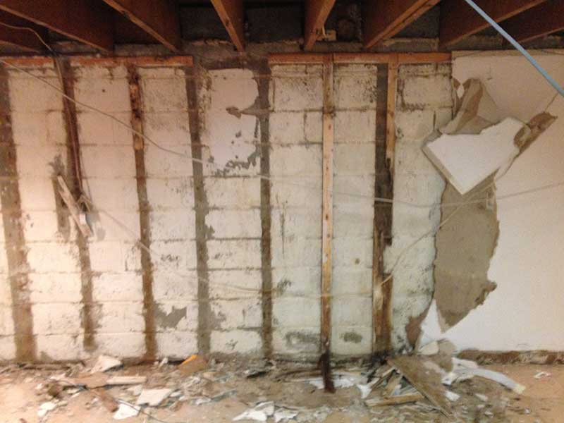 Removing drywall in basement to prep for a full perimeter pressure relief french drain system